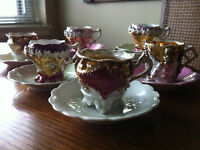 ANTIQUES: 6 PORCELAIN CUPS AND 9 SAUCERS MADE IN GERMANY