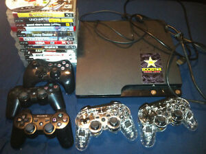 250GB PS3 Slim, 5 controllers & 14 games