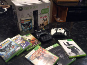 USED XBOX 360, 7 GAMES, NETWORKING ADAPTER AND 2 CONTROLLER