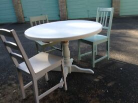 A painted pine pedestal table.