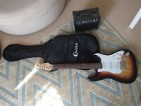 Electric guitar with carry bag and amp