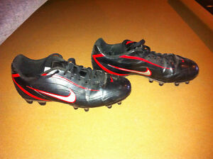 Nike woman football shoes, size 9.