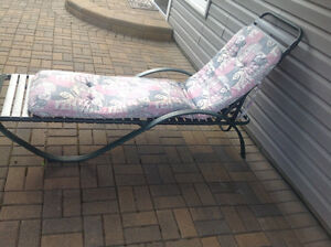 Adjustable Lounger with Cushion.