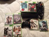 Xbox 360 slim 250gb with 8 games.
