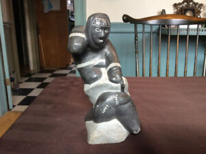 "VINTAGE INUIT SOAPSTONE CARVING ""HUNTER WITH SEAL"""