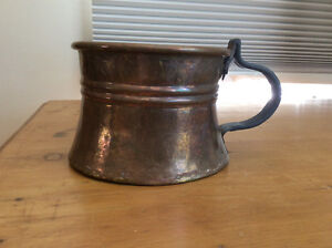 Antique copper pot with wrought iron handle