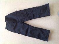 Boys or girls unisex black Trespass salopettes/ padded ski trousers