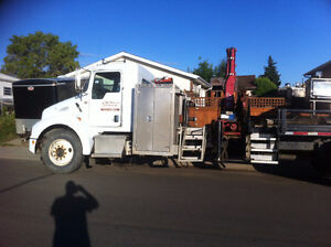 2003 Kenworth picker truck with flat deck.