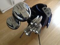 GOLF CLUBS FULL SET OF LIGHT WEIGHT CAVITY BACK IRONS WITH STEEL SHAFTS. WOODS PUTTER AND BAG as new
