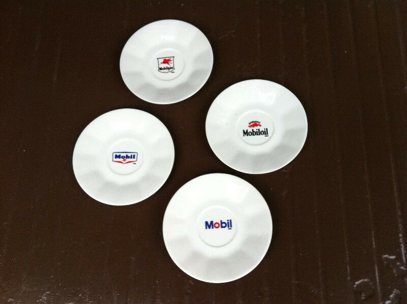 Mobil collectibles 4 plates of changing Mobil logo