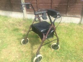 Mobility walker with seat. Tri walker