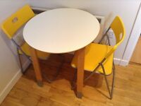 IKEA small round table and 2 folding chairs