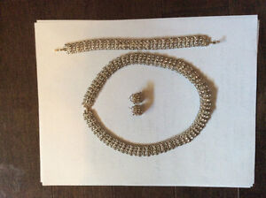 Silver necklace with earrings and bracelet