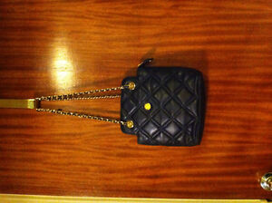 New black leather purse with gold and leather carrying strap