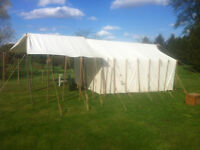 Colonial tent with wood stove sleeve