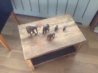 Reclaimed wooden scaffold board coffee table with storage shelf.