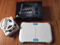 BLACK Wii in excellent condition with Wii Fit Board & 9 Games