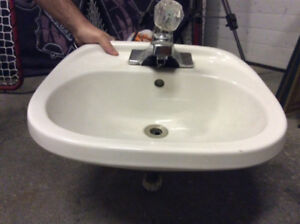 White porcelain sink with faucet