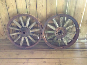 Well weathered wood spoke antique car wheel(s)