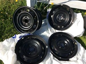 Four Brand New 5 stud Rims  (Off Madza)
