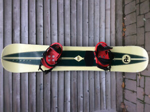 Snowboard with Burton bindings and Atomic boots for sale