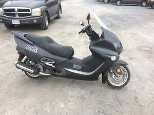 Scooter 250cc saga built for around town or highway speeds $2500