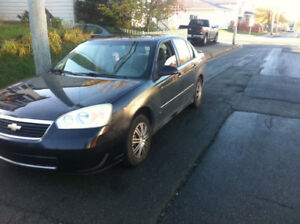 2006 Malibu LT great shape and it's a 4 cyliner