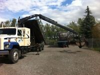 Tandem picker truck with hyd grapple and tilt deck