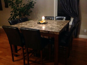 Solid Granite/Wood dining table and 8 chairs for sale