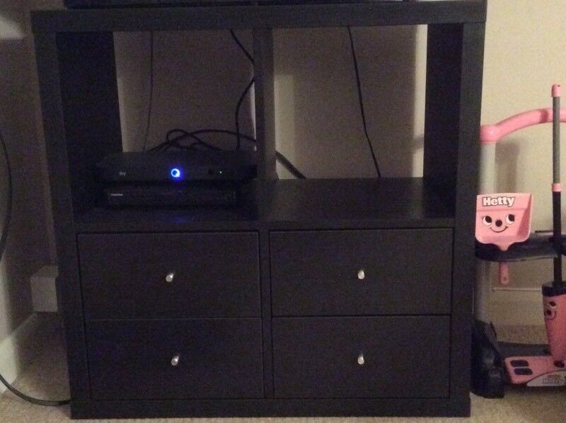 Black IKEA Kallax unit with drawers