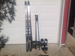 Downhill skis, boots, and poles