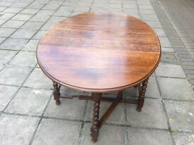 Gorgeous oak drop leaf table with barley twist legs.