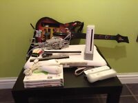 Nintendo WII With Wii fit board, guitar hero and games