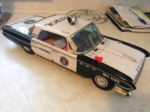 Never played with 1960's tin Buick invicta friction police car