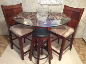 Pub height table and 2 chairs. Sale can include 2 stools.