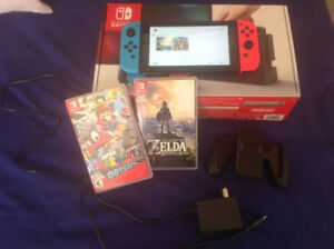 Nintendo switch with zelda breath of the wild and Mario Odessey