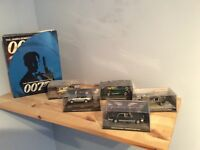James Bond car collection with original magazines.