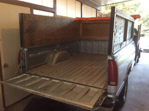 Truck box trailer with sides & equipment ramp in front