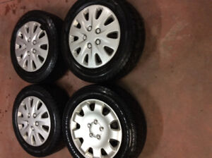 FOUR ON RIM GOODYEAR TIRES