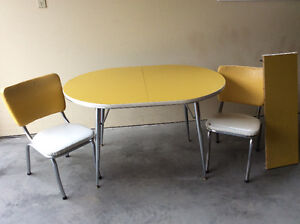 Two white and yellow retro chairs