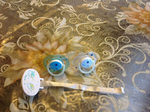 Brand new pacifier ,bottle ,nipples and pacifier clip