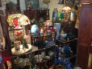 Tiffany style lamps, cast and ceramic hardware, Persian rugs....