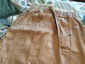 Pair of brown long length curtains