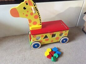 Lovely colourful wooden shape sorter and ride on toy.