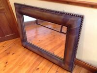 Real brown leather copper studded mirror.