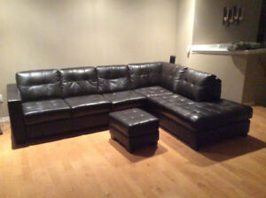 Leather sectional couch and foot stool