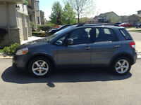 2009 Suzuki SX4 Hatchback + additional snow tires.