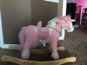 Gently used pink rocking horse