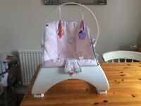 Baby bouncer with vibration