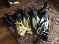 Men and women scuba diving gear, flippers, mask boxed, snorkel, boots